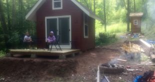 Added siding and a small deck to the front of my pallet shed bunkhouse on Potato